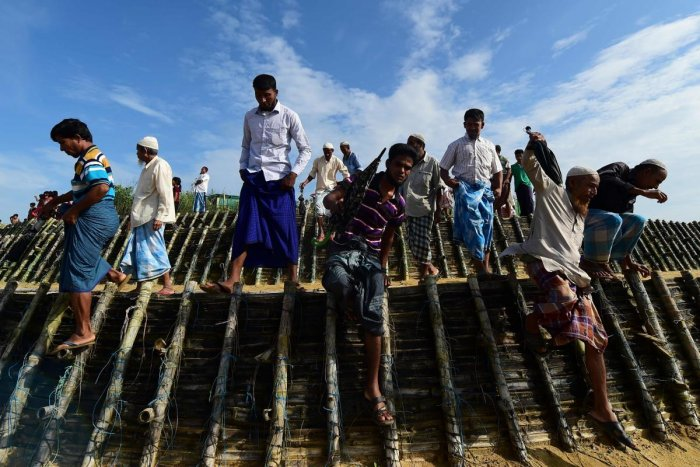 Rohingya refugees arrive to attend a ceremony organised to remember the second anniversary of a military crackdown that prompted a massive exodus of people from Myanmar to Bangladesh, at the Kutupalong refugee camp in Ukhia on August 25, 2019. (Photo by A