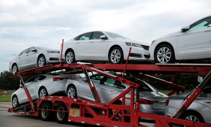 A car hauler transports newly built Chevrolet Impalas from the General Motors Detroit-Hamtramck plant in Detroit, Michigan, U.S. September 15, 2019. (Photo by Reuters)