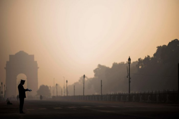 A soldier waits on a street near India Gate in heavy smoggy conditions in New Delhi on December 6, 2019. Credit: AFP Photo
