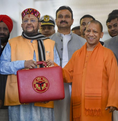 Uttar Pradesh Chief Minister Yogi Adityanath (R) and Finance Minister Suresh Khanna before the presentation of State Budget 2020-21 in the UP Legislative Assembly, in Lucknow, Tuesday, Feb18, 2020. (PTI photo)