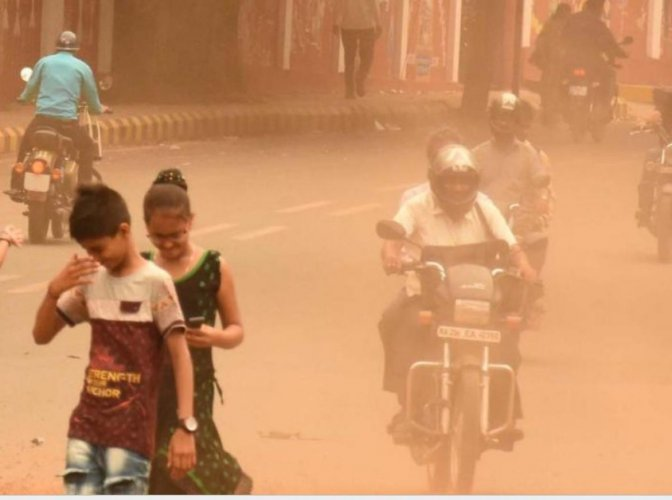 It has become common for the people to use masks to prevent inhaling of dust in Mysuru. Photo for represenation