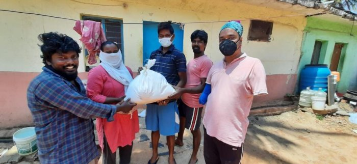 Shubhajit Bhattacharya and Juli Aich deliver essential commodities to the needy.