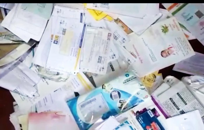 Documents that have not been delivered to the concerned people by a postman at Soorlabbi near Suntikoppa.