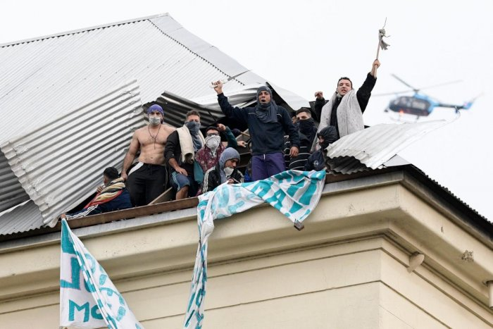 Inmates protest on the roof of Villa Devoto prison demanding measures to prevent the spread of the Covid-19 coronavirus, after a case was reported inside the detention center, in Buenos Aires. AFP