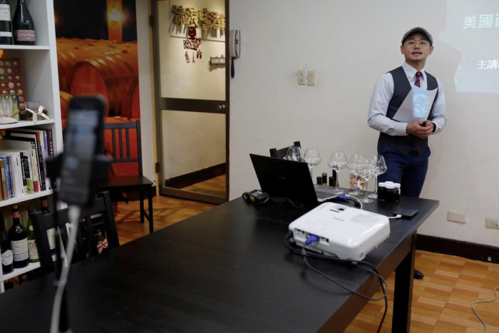 Sommelier Peter Petrus conducts online wine tasting classes in Taipei, during the global outbreak of the coronavirus disease. Reuters
