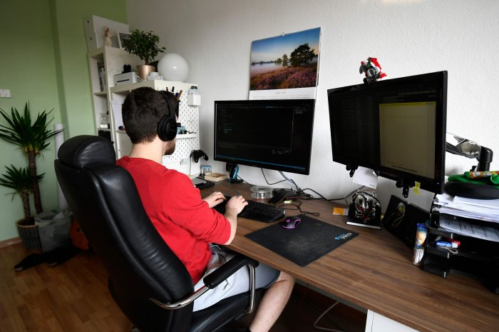 Student Thilo makes home-office for his computer science job in his room of a flat-sharing in Dortmund, western Germany. (Credit: AFP Photo)