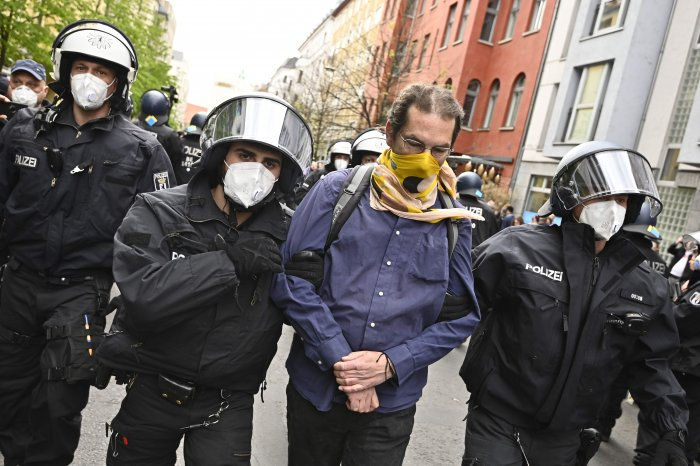Police remove a demonstrator during a protest against the Corona restrictions in Berlin. (AFP Photo)