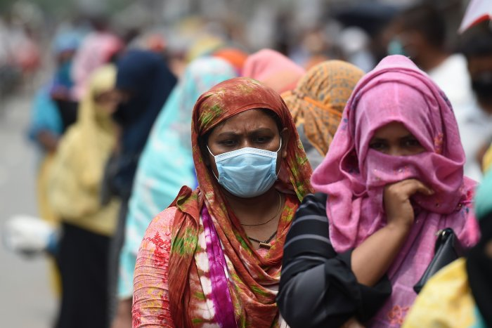 People queue to collect subsidised food items during a government-imposed nationwide lockdown as a preventive measure against the COVID-19 coronavirus, in Dhaka. (Credit: AFP Photo)