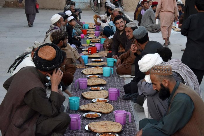 Afghan Muslims wait to break their fast during the Islamic holy month of Ramadan at a mosque in Kandahar. Credit: AFP Photo