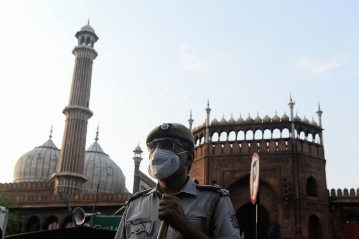 A police officer stands guard outside Jama Masjid during a government-imposed nationwide lockdown as a preventive measure against the spread of the COVID-19 coronavirus, in the old quarters of New Delhi on April 25, 2020. Credit: AFP Photo