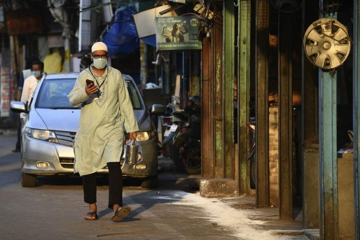 A resident wearing a facemask walks on a street during a government-imposed nationwide lockdown as a preventive measure against the spread of the COVID-19 coronavirus, in the old quarters of New Delhi on April 25, 2020. Credit: AFP Photo