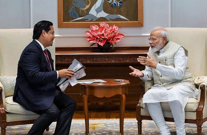 Prime Minister Narendra Modi and Meghalaya Chief Minister Conrad K. Sangma. (PTI Photo)
