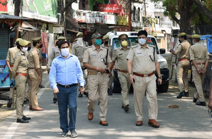 Police personnel patrol in Telierganj area, identified as a COVID-19 hotspot, during the nationwide lockdown to curb the spread of coronavirus. (PTI Photo)