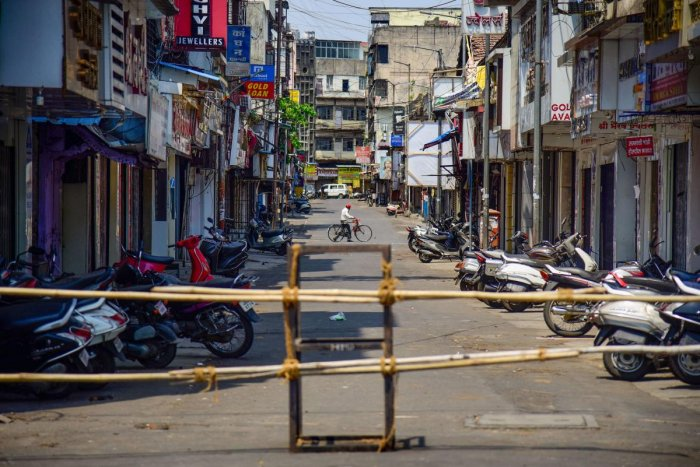 Barricades are seen at Khadki Cantonment after seven family members of a COVID-19 positive patient tested positive for the coronavirus infection during a nationwide lockdown in the wake of coronavirus pandemic, in Pune, Saturday, April 18, 2020. (PTI Photo)