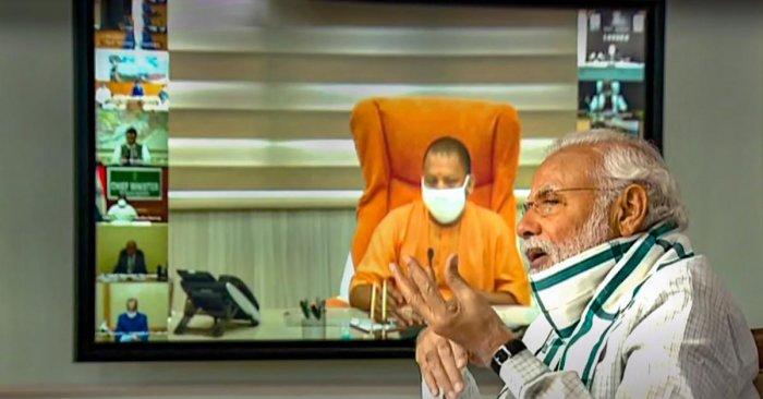 Prime Minister Narendra Modi (front) interacts with the Chief Ministers of various States/UTs via video conferencing to discuss the situation arising due to the novel coronavirus pandemic, in New Delhi, Monday, April 27, 2020. UP CM Yogi Adityanath is also seen on the screen. (TV GRAB/PTI Photo)