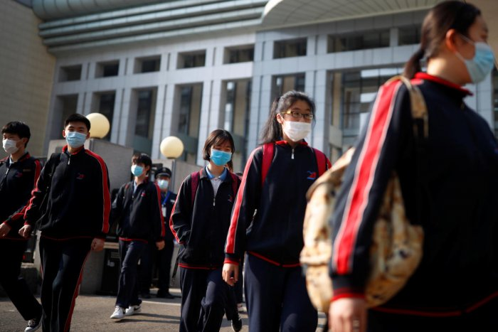 Students wearing face masks leave a school in Beijing, China as senior high school students in the Chinese capital returned to campus following the coronavirus disease (COVID-19) outbreak, April 27, 2020. Credit: Reuters Photo