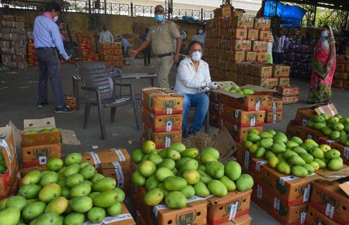 A fruit vendor waits for customers at Azadpur Sabzi Mandi during a nationwide coronavirus lockdown to curb the spread of coronavirus, in New Delhi. (PTI Photo)