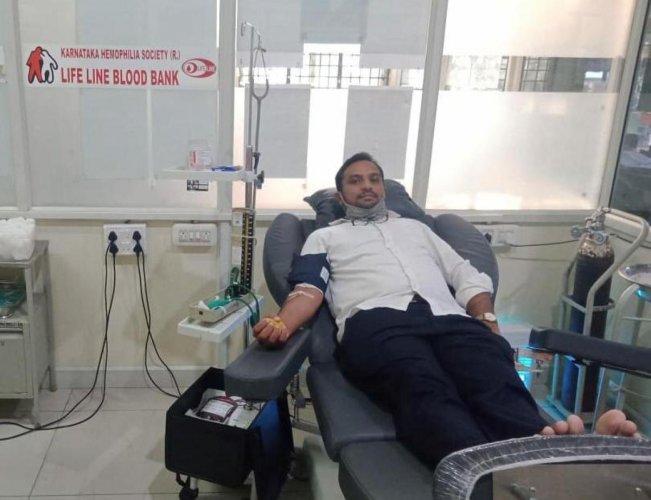 A volunteer donates blood at Life Line Blood Bank of Karnataka Haemophilia Society in Davangere.