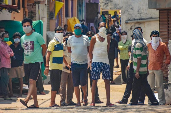 Residents of Baldevgarh area protest against setting up of a quarantine centre for COVID-19 case in their locality, during ongoing lockdown in Jabalpur, Sunday, April 26, 2020. (PTI Photo)
