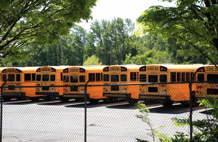 Parked school busses sit in a lot during the coronavirus (COVID-19) pandemic in Charlotte, North Carolina. (AFP)