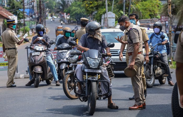 personnel question commuters for stepping out of their houses, during the nationwide lockdown to curb the spread of coronavirus. (PTI Photo)