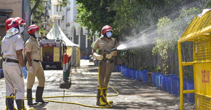 Firefighters spray disinfectants at a locality near Nizamuddin mosque during a nationwide lockdown in the wake of coronavirus pandemic, in New Delhi, Thursday, April 2, 2020. Credit: PTI Photo