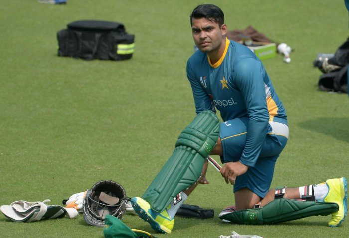 In this file photo taken on March 13, 2016 Pakistan's Umar Akmal pads up as he takes part in a training session ahead of the World T20 cricket tournament match at The Eden Gardens Cricket Stadium in Kolkata. Credit: AFP Photo