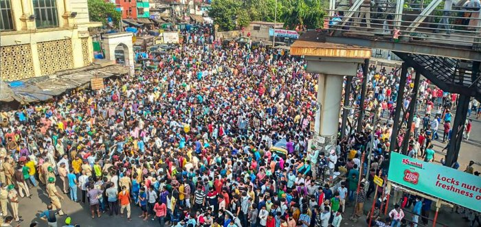 Migrant workers gather outside Bandra West Railway Station as they defy lockdown norms and request to leave for their native places after Prime Minister Narendra Modi had announced the extension of nationwide lockdown till May 3 in the wake of coronavirus pandemic, in Mumbai, Tuesday, April 14, 2020. Credit: PTI Photo