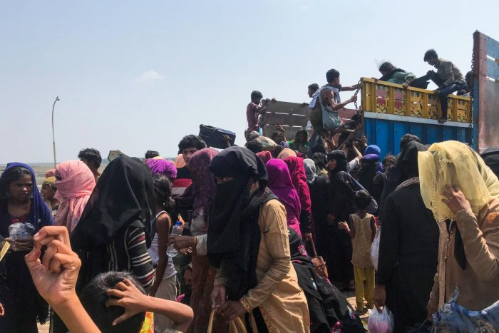 Rohingya refugees get in a truck following their arrival by a boat in Teknaf on 16 April 2020. Credit: AFP Photo