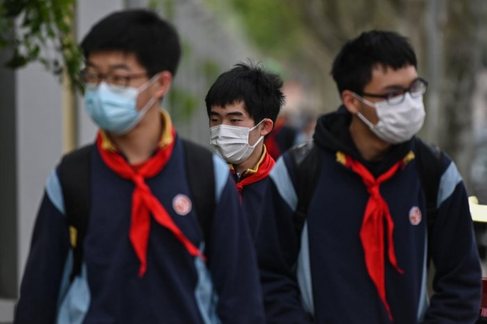 Students wearing face masks arrive at the Huayu Middle School in Shanghai on April 27, 2020. Credit: AFP Photo