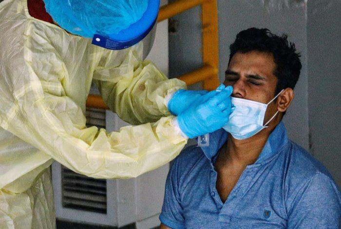 A medical worker performs a nose swab test on a migrant worker at a dormitory amid the coronavirus disease (COVID-19) outbreak in Singapore, April 28, 2020. Credit: Reuters Photo