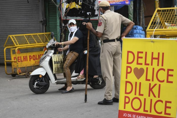 A motorist is stoped by a police officer at a checkpoint during a government-imposed nationwide lockdown as a preventive measure against the spread of the COVID-19 coronavirus, in the old quarters of New Delhi on April 23, 2020. Credit: AFP Photo