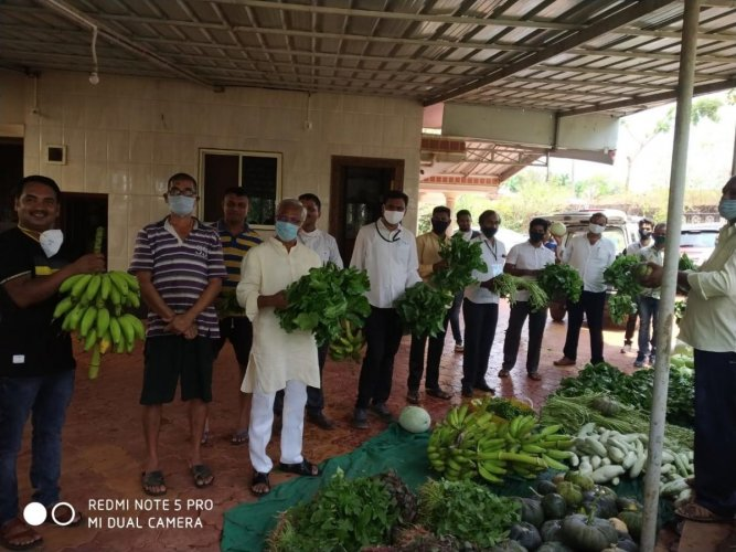Former MLA J R Lobo procures vegetables from a farmer at Merlapadavu.