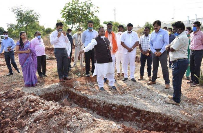 Rural Development and Panchayat Raj Minister K S Eshwarappa inspects a project at Narasapur in Kolar district on Monday.