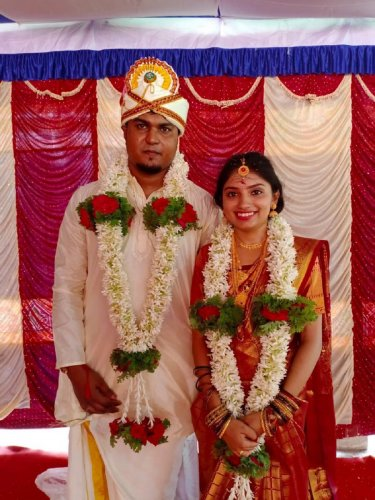 Sanup Nair and Spandana Rai who entered into wedlock in a simple function in Bhagamandala on Sunday. DH Photo