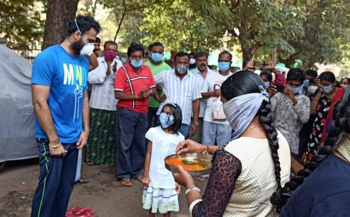 Residents welcome Vinay Kumar (P185), who was discharged after recovering from Covid-19 at Swarnasandra Layout, in Mandya on Tuesday.