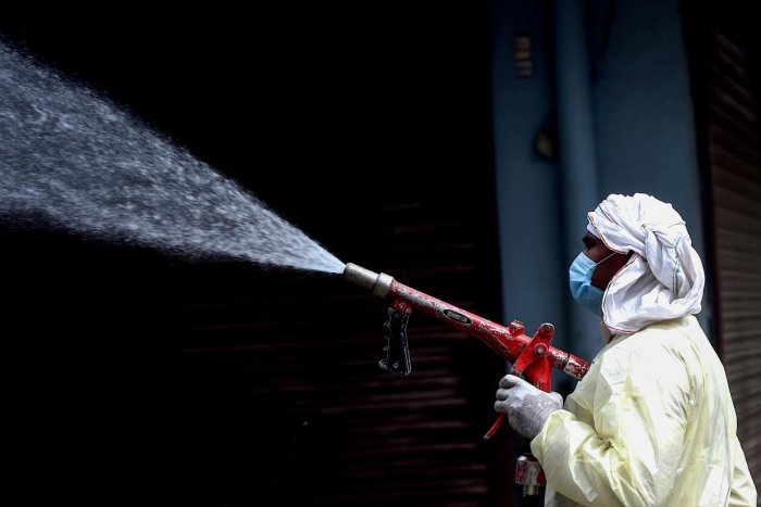 A municipal worker sprays disinfectant solution to sanitise a residential area during a government-imposed nationwide lockdown as a preventive measure against the spread of the COVID-19 coronavirus in Faridabad on April 15, 2020. Credit: AFP Photo