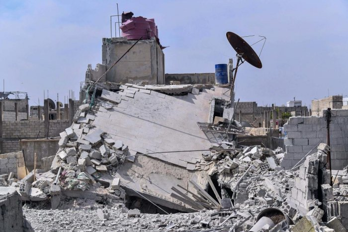 This photo released by the Syrian official news agency SANA, shows the rubble of a house that according to the Syrian authorities was attacked by an Israeli airstrike, in the Damascus suburbs of Hajira, Syria, Monday, April 27, 2020. Credit: AP Photo