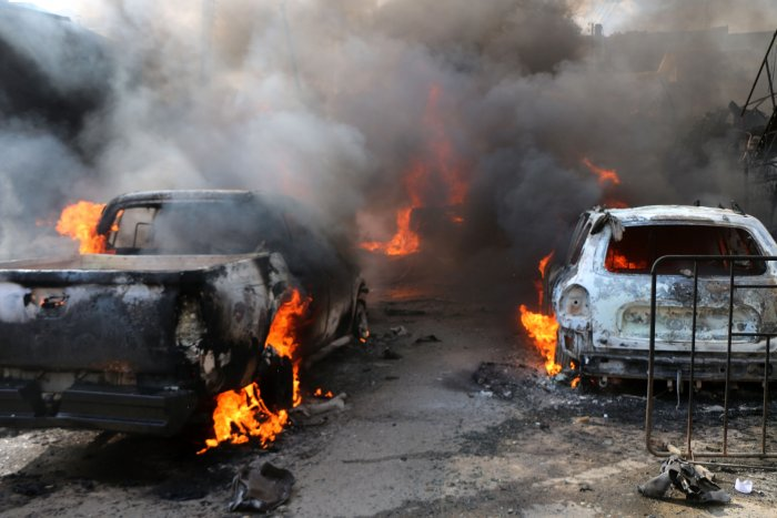 A handout picture released by the Syrian Civil Defence rescue workers, also known as White Helmets, shows the scene of a fuel truck bomb in the northern Syrian city of Afrin, controlled by Ankara's proxies. (AFP)