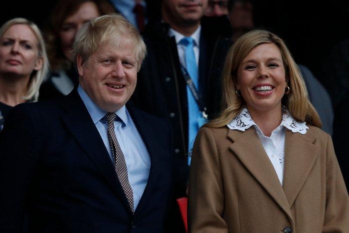 Britain's Prime Minister Boris Johnson (L) with his partner Carrie Symonds. (AFP Photo)