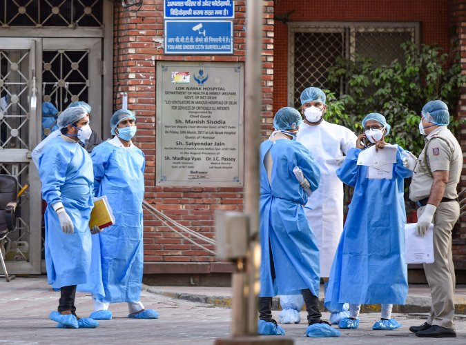 Medics wearing protective suits are seen in the premises of LNJP hospital. (PTI Photo)