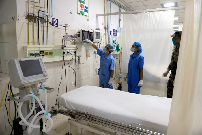 Nurses work for setting up of a quarantine facility for COVID-19 cases, during ongoing nationwide lockdown, at an Army hospital in Prayagraj. (PTI Photo)