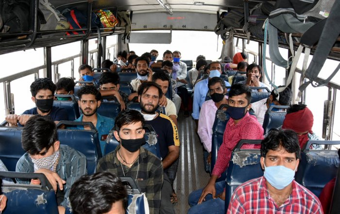 Migrants board a bus to their native villages, during the nationwide lockdown to curb the spread of coronavirus, in Jodhpur. (PTI Photo)