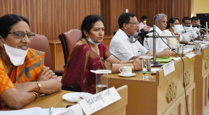 District In-charge minister V Somanna chairs a meeting in Zilla Panchayat Auditorium in Madikeri on Tuesday. DH Photo