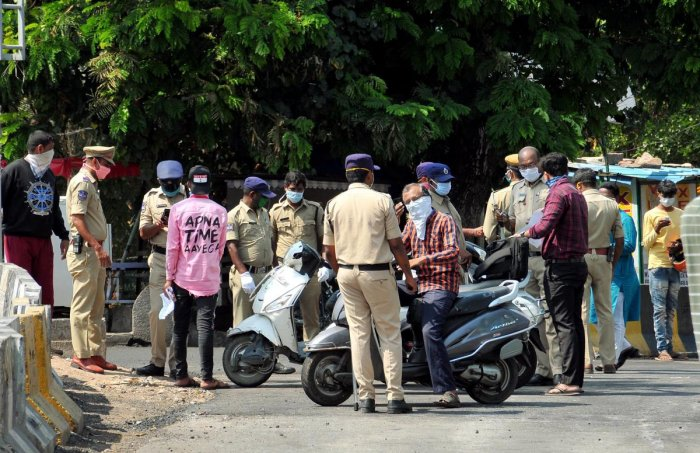 Police personnel question commuters for stepping out of their houses, during the nationwide lockdown to curb the spread of coronavirus, in Hyderabad, Thursday, April 23, 2020. (PTI Photo)