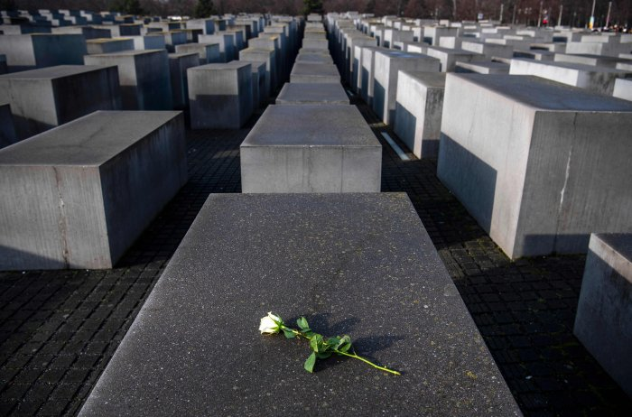 A rose lying on one of the concrete steles of the Memorial to the Murdered Jews of Europe (Holocaust memorial) in Berlin, to commemorate the 75th anniversary of the liberation by Soviet troops of the Auschwitz-Birkenau concentration camp in Poland. (AFP Photo)