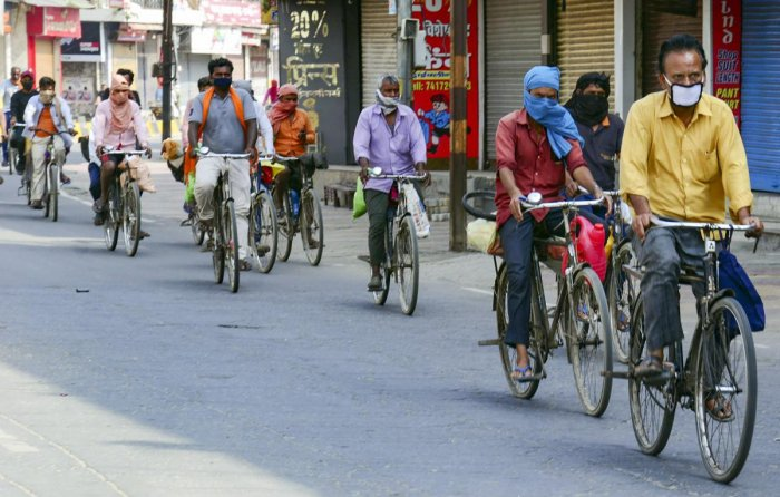 Some among 25 migrant workers who are cycling to their native place from Haryana amid COVID-19 lockdown, pass through Muzaffarnagar, Thursday, April 30, 2020. (PTI Photo)