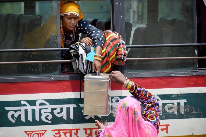 Migrant workers from Madhya Pradesh who were stranded in the city due to lockdown board a specially scheduled bus to reach their respective hometowns, in Prayagraj, Thursday, April 30, 2020. (PTI Photo)