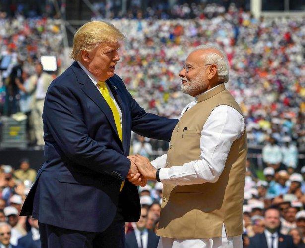 Prime Minister Narendra Modi shakes hands with US President Donald Trump during the 'Namaste Trump' event at Sardar Patel Stadium in Ahmedabad, Monday, Feb. 24, 2020. (PTI Photo)