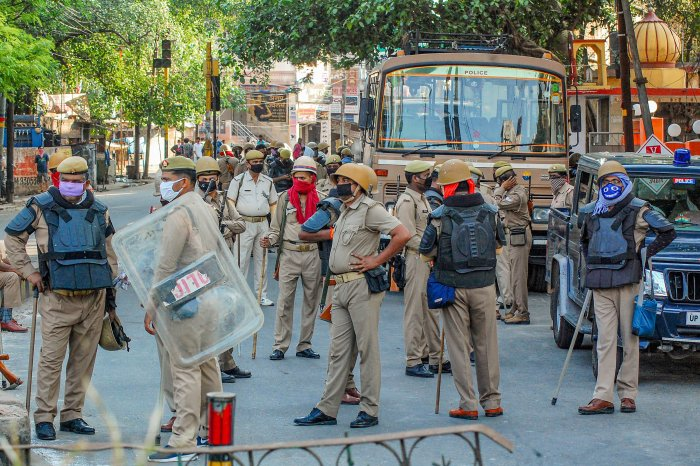 Heavy security deployment after locals allegedly pelted stones on a team of doctors and police officials, who had gone for a check-up of coronavirus suspects in one of the hotspot area, near Gulab Ghosi Masjid in Kanpur. (PTI Photo)